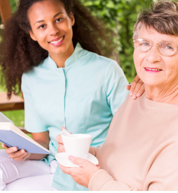 elderly woman and her caregiver spending leisure time