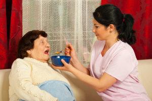 Nurse assisting elderly