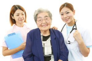 Nurses and elderly woman