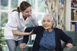 elder assisted by a caregiver